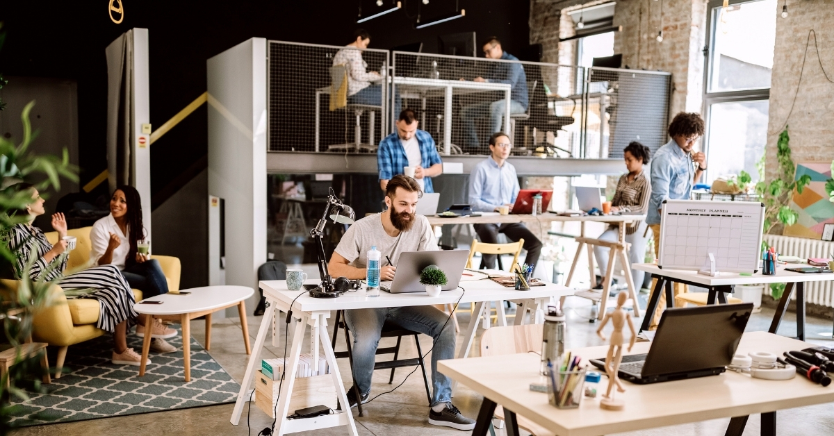 People working in a busy coworking space